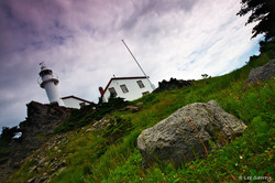 A tilted view of Lobster Head Cove Lighthouse