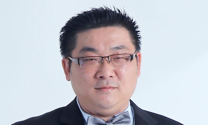 詹庆强博士 助人为本 推广传统文化