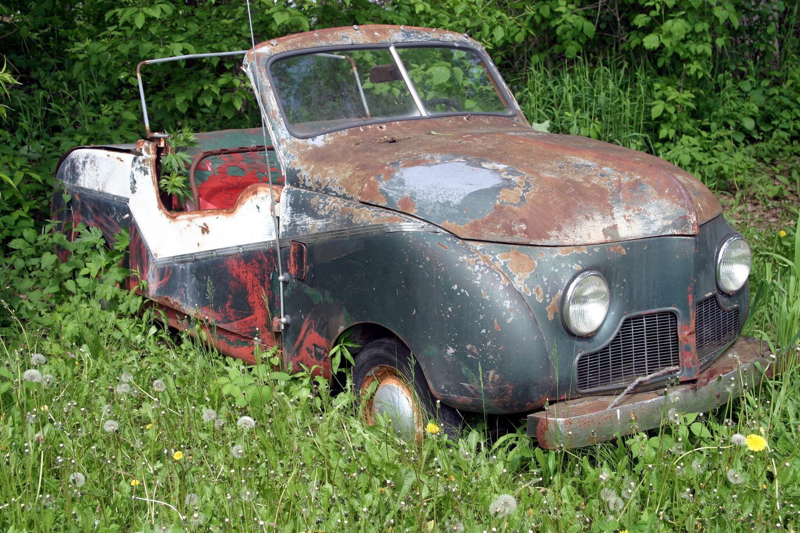 Old blue car in junk yard 08.jpg