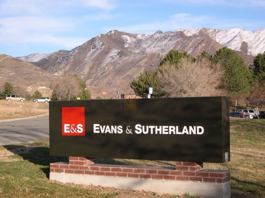 E&S landmark sign with mountains in backdrop