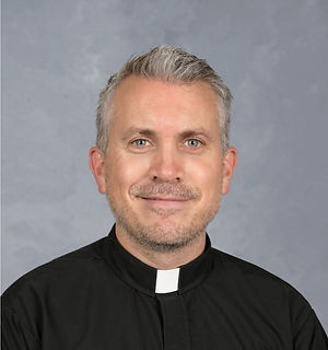 Father Aaron school pic.jpg