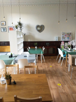 Cock pit farm tea rooms interior showing tables and chairs