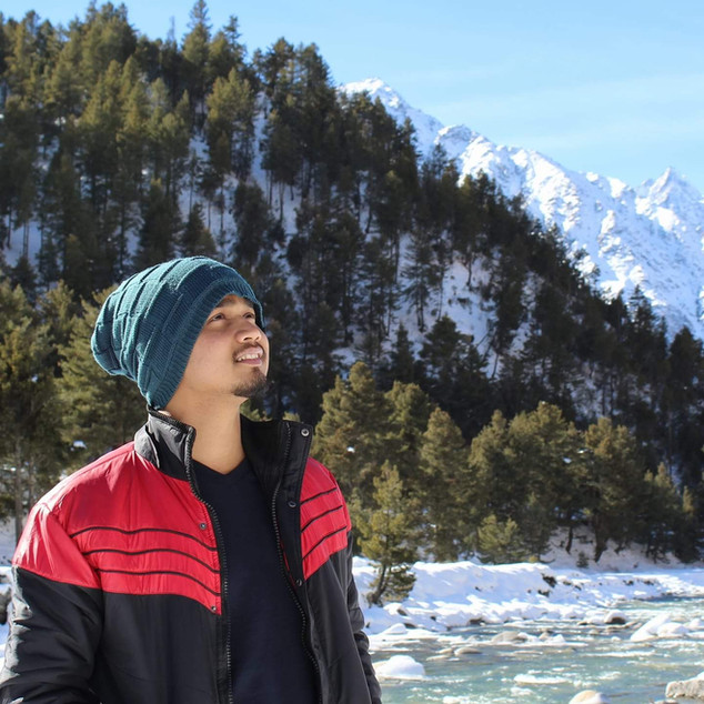 Traveler enjoying the scenic view of Lad