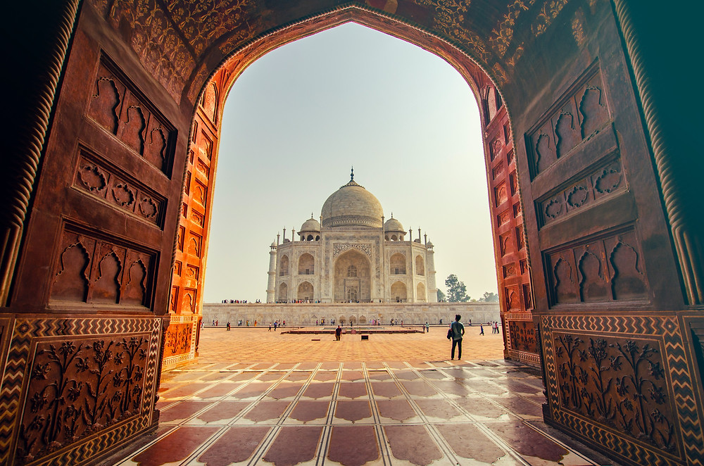 Taj Mahal as seen from a photography spot in an arch.