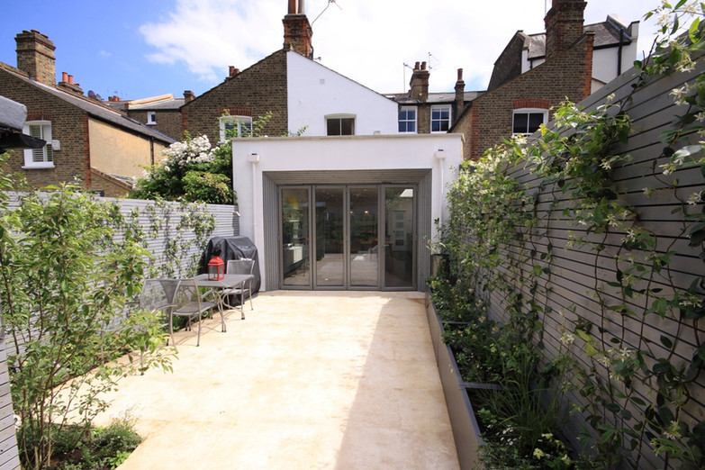 White render rear extension for a terraced house