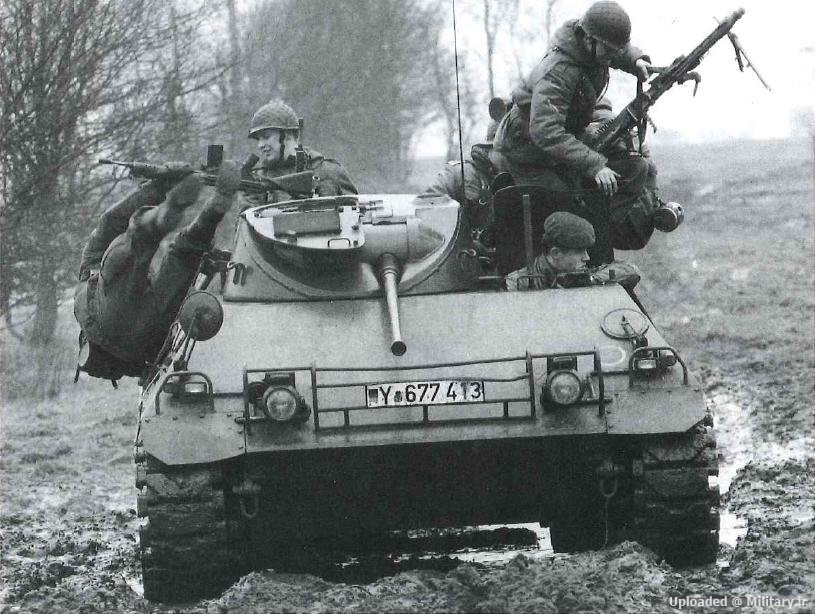 German soldiers dismount from an HS.30 Lang