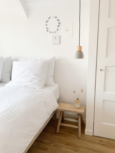 Slaapkamer met uizicht op de boog