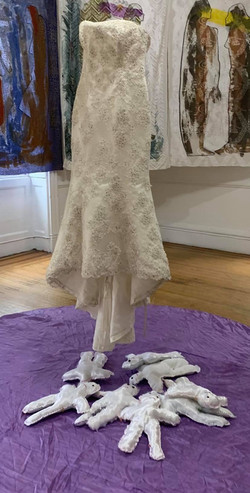 A Women Memories, Object consests of a wedding dress and 10 folklore dolls the dress 120 x 60 x 60 I