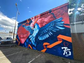 1 mural 75jaarvrij schuin Zon.jpeg