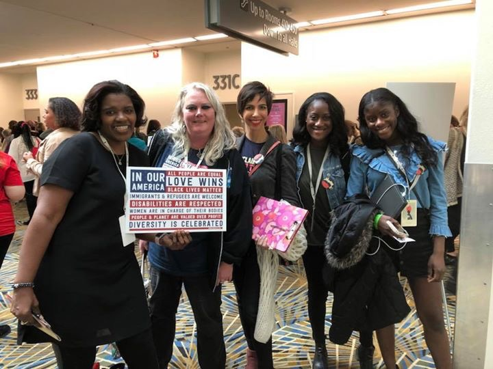 Kirsten Hunter poses with new friends at the convention