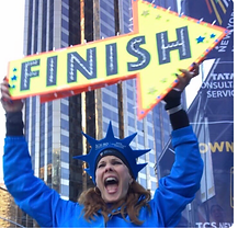 Tracey B. Wilson with her FINISH LINE sign, hosting at the NYC Marathon.