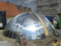 Kuppel formet Zinktag med stående flse vi har udført til Mediehuset i Aabenraa