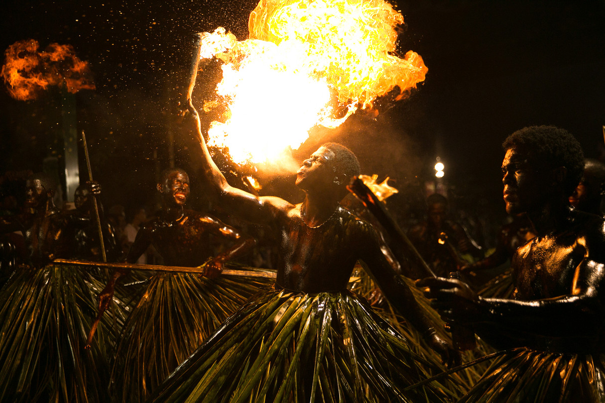 A man breaths fire during a carnival in Santo Domingo