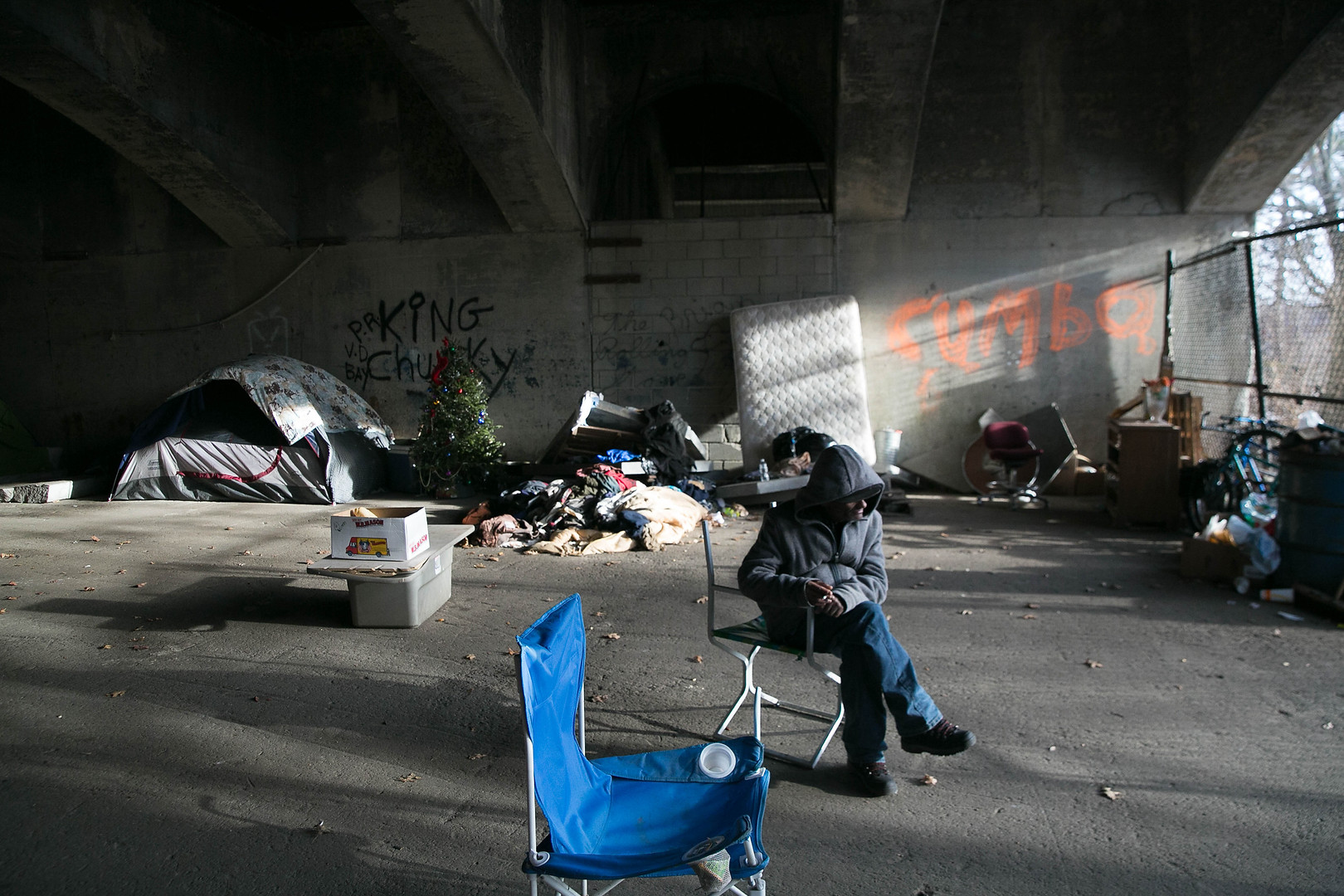A opiate addict is seen high in a homeless encampment in Lawrence, MA
