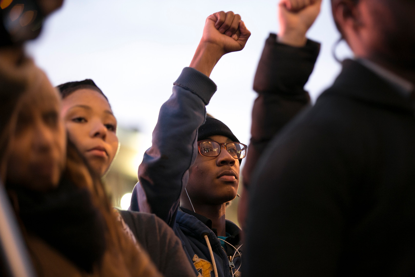A young man raises a fist during a protest of the killing of Michael Brown in Philadelphia