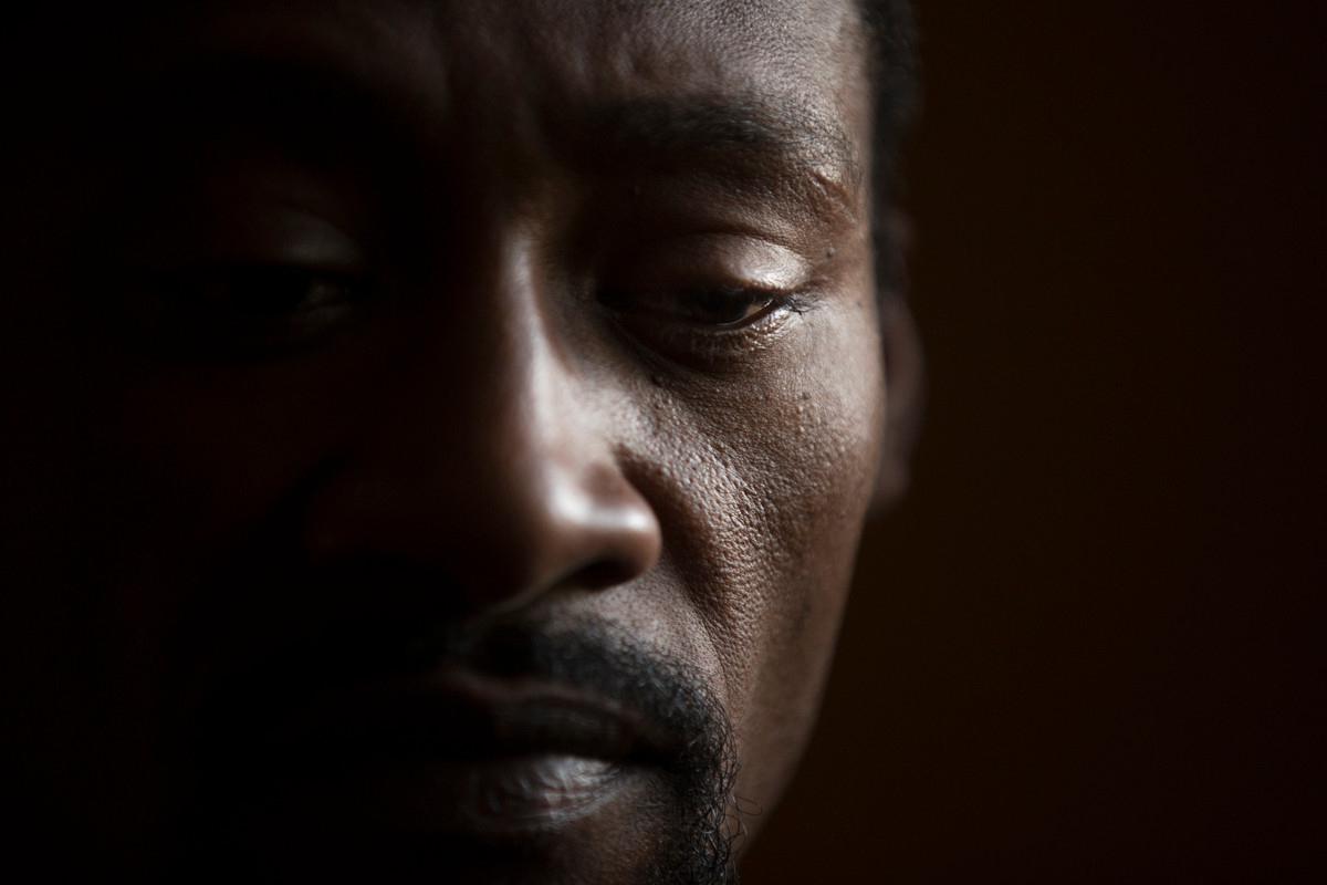 """Dwada EN Ceesay - """"I have been mourning for a long long time. I lost my brother... I don't know why and I don't know how - he left home and never came back. I was the last person he talked to. He was a soldier...someone I loved...I went to the barracks to find out about him. I asked because I thought it was a normal thing to ask. I was tortured and I was asked to monkey dance over 500 times...it was very painful and when I couldn't stand it anymore they started hitting me. They hit me with the back of the rifle."""" Dwada EN Ceesay, 39 years old still has the scars on his eyebrow from where he was beaten at the age 16 when he went to inquire about the disappearance of his oldest brother Ebrima Ceesay, a soldier who was killed under the regime of former Gambian President Yahya Jammeh."""
