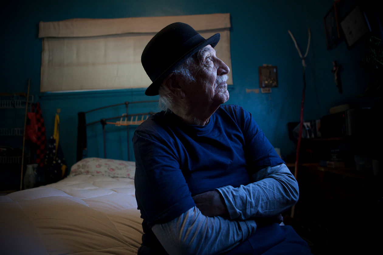 Mr. Pacheco, sits on his bed in his home in which he believes he will draw his last breaths. Santa Fe, NM