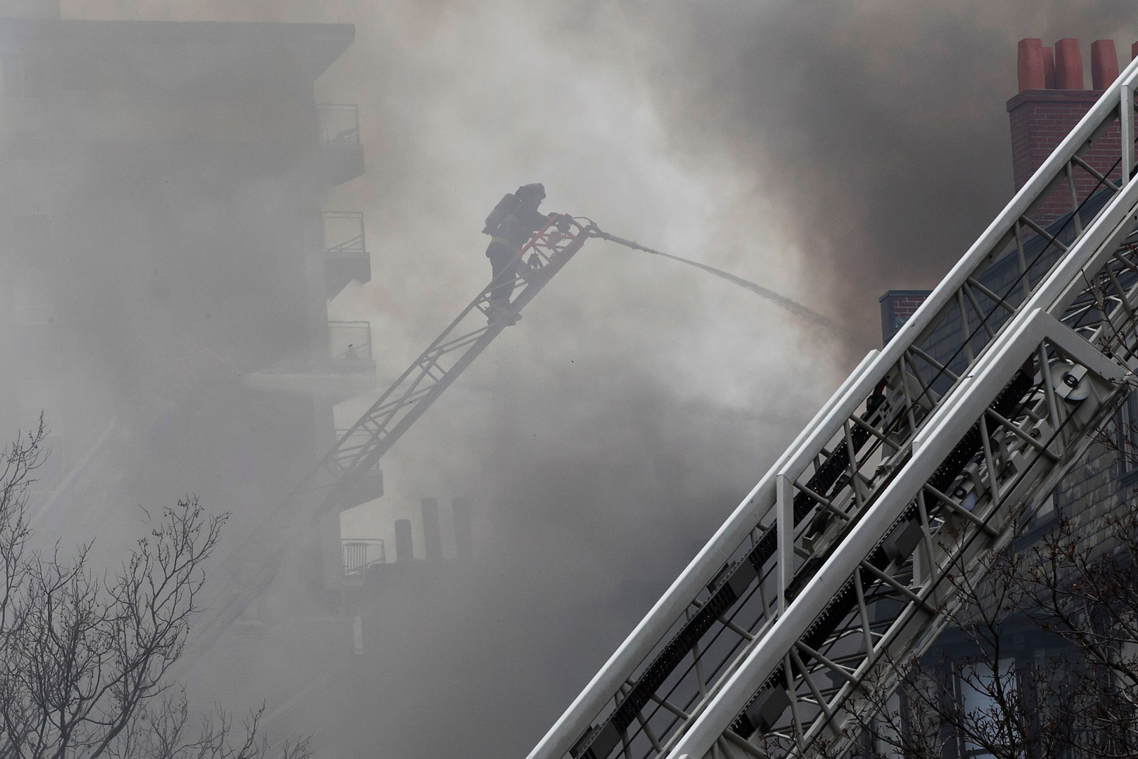 Boston firefighters respond to a 9 alarm fire in the Back Bay which ultimately took the lives of two firefighters