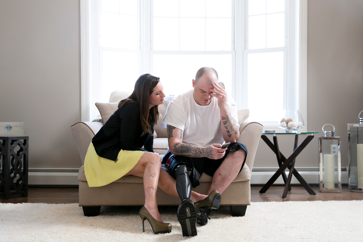 """Jaqui Webb and her fiancé, Paul Norden were both injured in the Boston Marathon bombings in 2013.  Jaqui had shrapnel in her right leg and Paul lost his right leg. This image was taken for the article """"A Year After the Boston Marathon Bombings, Injured Brothers Endure"""" for The New York Times"""