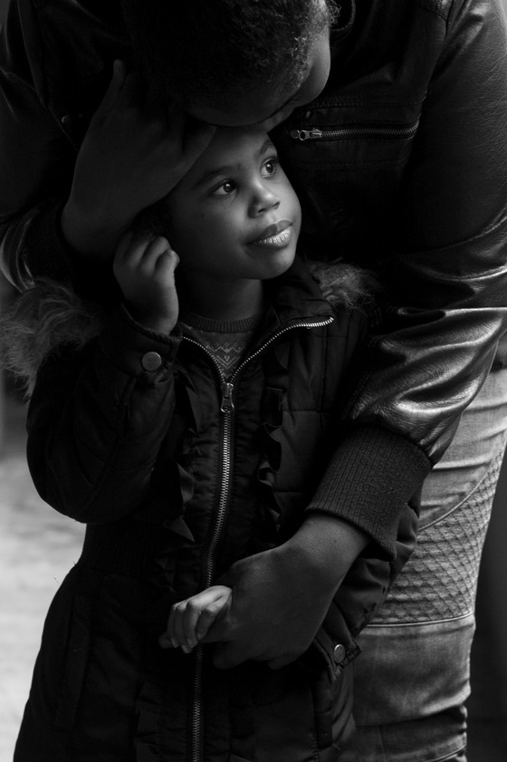 """India Wayman, a single mother, embraces her daughter Naimah Ife who has severe ADHD and dyspraxia. """"There's power in a name,"""" Ms. Wayman said of the name she chose for her daughter. Naimah means """"peace"""" in Arabic and Ife is """"love"""" in Swahili. """"Now, for the rest of her life, she will have love and peace, even when I'm not there."""" This image was taken for the article """"Single Mother Seeks to Give Daughter the Peace That Eluded Her"""" for The New York Time"""
