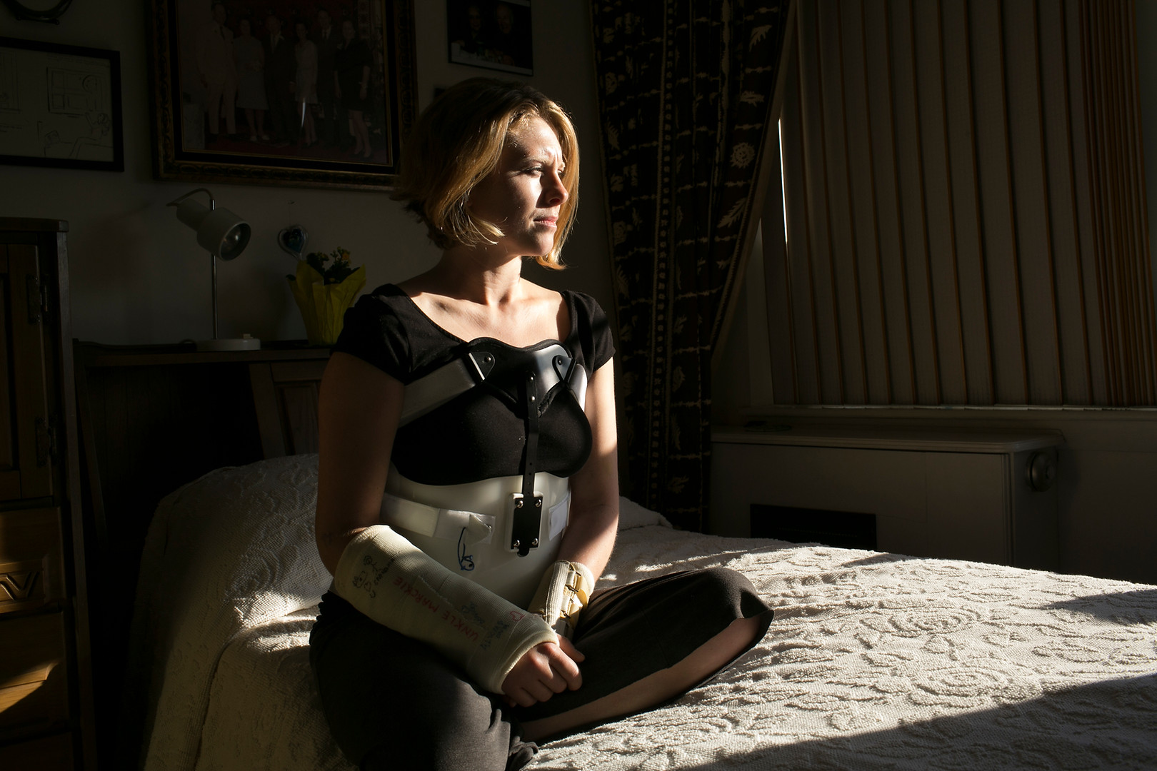 "Ryan McMahon, 33, fractured her back and broke both wrists in the panicked moments after the Boston Marathon bombings.  This image was taken for the article ""Victims in Boston Face a Difficult Path to Recovery"" for The New York Times"