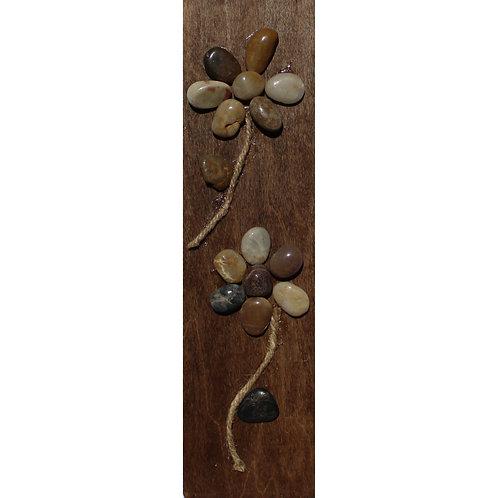 Rock flowers on wood
