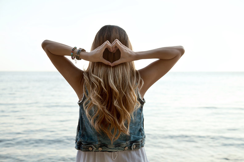 Heart shape hands, blonde hair with low