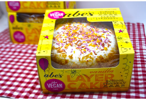 Clouds of frosting and vibrant sprinkles make this fluffy vanilla layer cake a dream!
