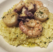 Seafood risotto with scallops, octopus a