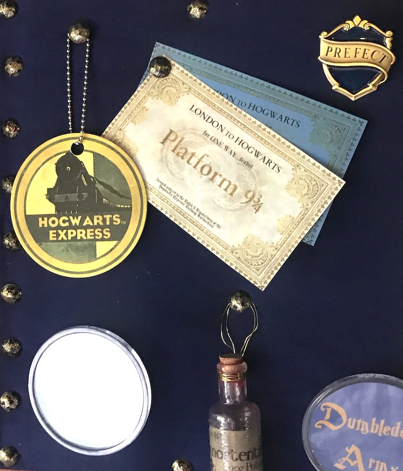 Ravenclaw keepsakes on bulletin board
