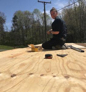 Emily installing roof sheathing