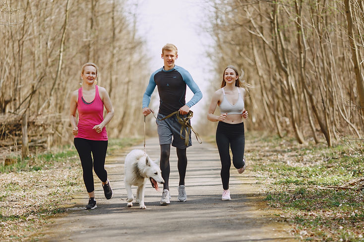 photo-of-two-women-and-man-jogging-with-
