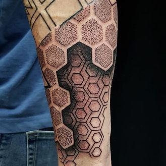 geometric tattoo, arm tattoos, camden tattoo artist, holloway tattoo artist, custom tattoo studio in camden, black and grey tattoos, best custom tattoo artist near me, london geometric tattoo, dotwork in camden