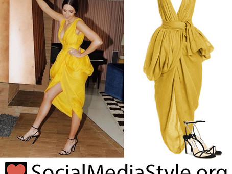Mandy Moore's yellow draped dress and black sandals from the 2021 MTV Movie & TV Awards
