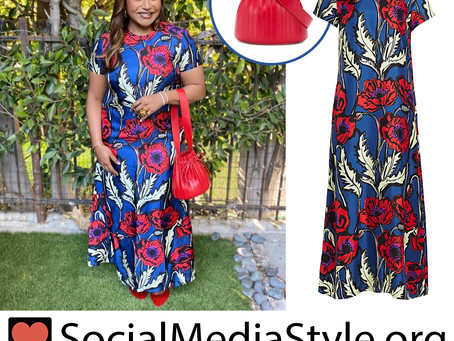 Mindy Kaling's large floral print dress and red bucket bag