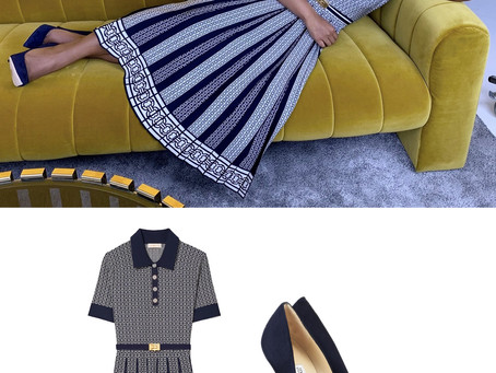 Mindy Kaling's navy print collared dress and navy pumps