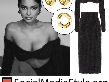 Kylie Jenner's hoop earrings and black crop top and skirt from ELLE Russia
