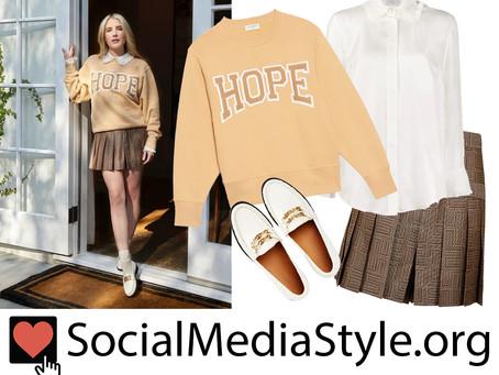 """Emma Roberts' """"Hope"""" sweatshirt, ruffled collar shirt, brown skort, and white loafers"""