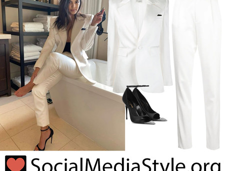 Kourtney Kardashian's white blazer and pants and black crystal cutout pumps