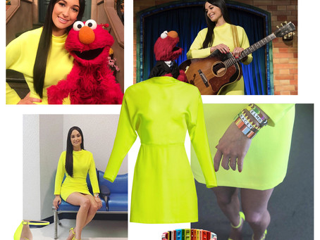 Kacey Musgraves' neon dress and sandals and beaded bracelets from The Not-Too-Late Show with Elmo