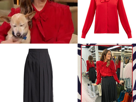 Drew Barrymore's chain hoop earrings, red blouse, and polka dot skirt from The Drew Barrymore Show