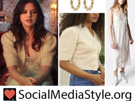 Selena Gomez's twisted gold hoops and cream cardigan and slip dress