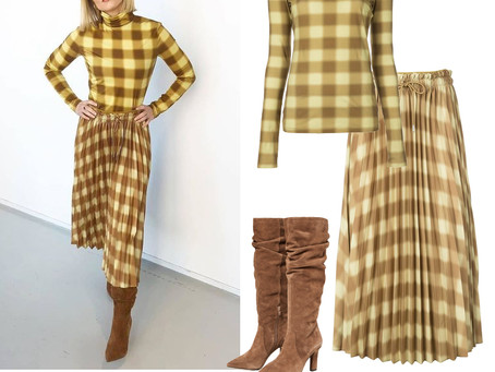 Kristen Bell's yellow plaid top and skirt and brown boots