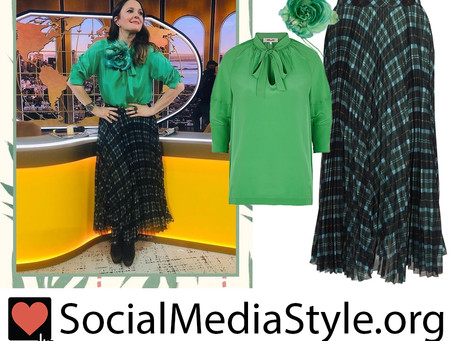 Drew Barrymore's green blouse, flower brooch, and tartan plaid skirt from The Drew Barrymore Show
