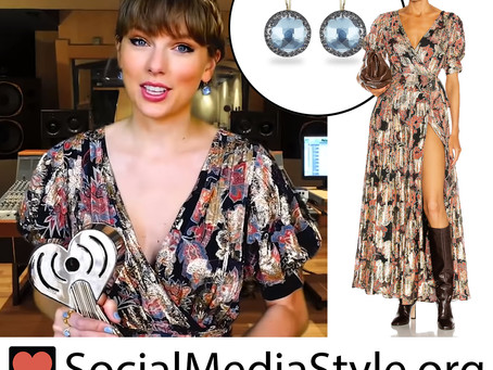 Taylor Swift's metallic puff sleeve dress and blue earrings from the 2021 iHeartRadio Music Awards