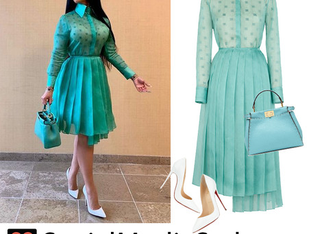 Cardi B's mint dress and bag and white pumps