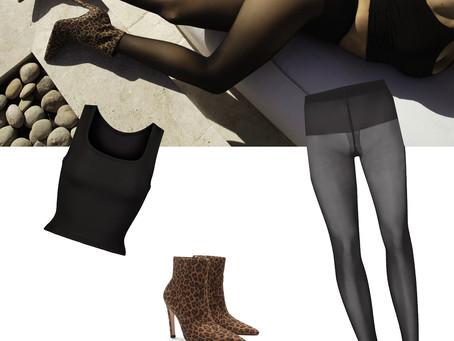 Khloe Kardashian's Skims black tank top and tights and Good American leopard print boots