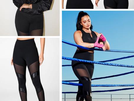 Demi Lovato for Fabletics black bomber jacket, zip detail sports bra, and mesh panel leggings