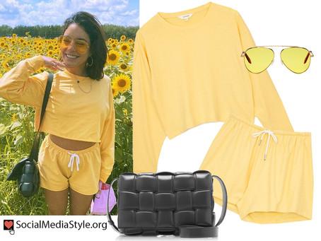 Vanessa Hudgens' yellow sweatshirt, shorts, and aviator sunglasses, and quilted black bag