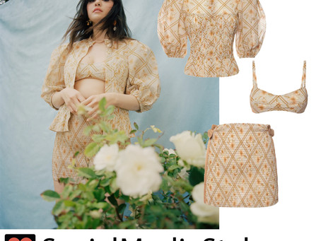 Selena Gomez's beige print blouse, bra top, and skirt from Vogue Magazine